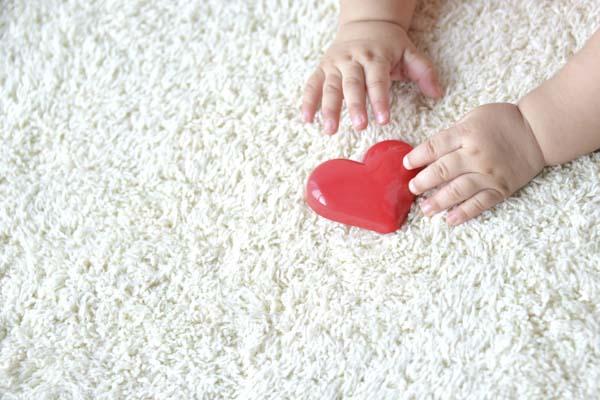 Baby playing on carpet